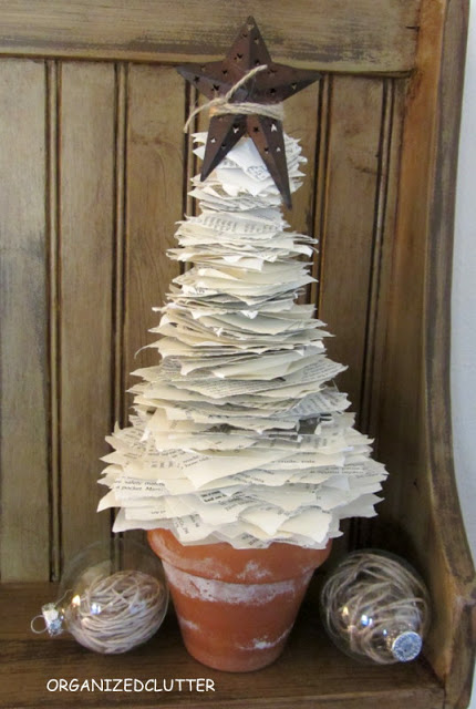 http://organizedclutterqueen.blogspot.com/2012/10/book-page-tree-jute-filled-ornaments.html